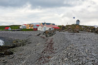 Houses and windmill in Vigur island, Iceland