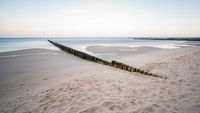 Coastal protection with groynes at the sea