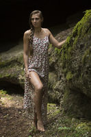 Beauty woman in primeval landscape