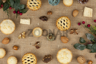Selection of mince pies at christmas on a hessian tablecloth