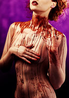 Beautiful sexy young woman. Body covered with a blood