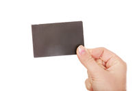 Young business woman holding small empty paper card