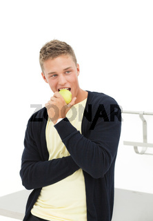 Young man with apple