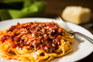 Closeup of tagliatelle pasta with bolognese ragu