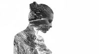 Silhouette of a woman combined with a rocky coast and sea. Double exposure, isolated on a white background. Black and white