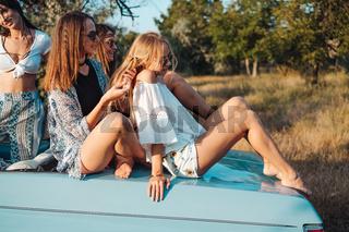 Girls plaiting pigtails
