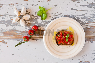 Italian bruschetta with tomato and basil seen from above
