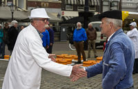 Cheese merchant and farmer bargain over the price of Gouda cheese by hand slapping,Gouda,Netherlands