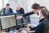 Startup business problem solving. Software developers working on desktop computer.