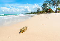 Old plastic bottle on beautiful tropical beach