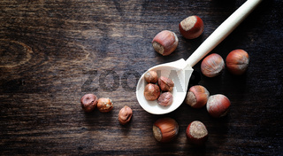 Nuts on a wooden table.Hazelnuts in the shells and shelled. A wo