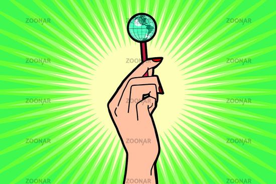 Earth Lollipop in female hand