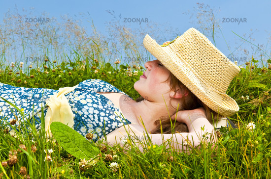 Young girl resting in meadow