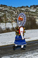 Beautiful Chlaus with ornate embroidered headgear,  Old Sylvester, Urnäsch, Switzerland