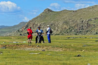 Motor-biker asking two men for direction in the steppe, Orkhon Valley, Mongolia