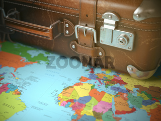 Travel and vacations background concept. Vintage suitcase on the world map.