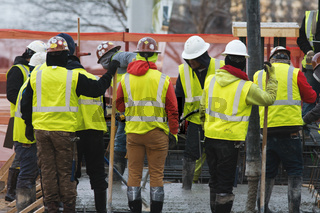 Group of builders on a construction site