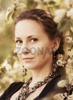 Portrait of happy beautiful fashion woman on nature
