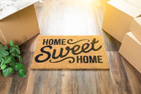 Home Sweet Home Welcome Mat, Moving Boxes and Plant on Hard Wood Floors