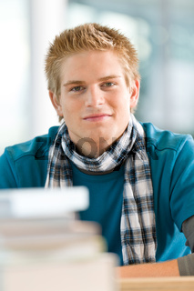 Portrait of male student with books