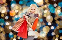 young woman in winter clothes with shopping bags