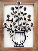 metal made flower and vase with wood frame