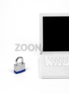 A laptop computer and a padlock isolaterd against a white background higlighting computer security