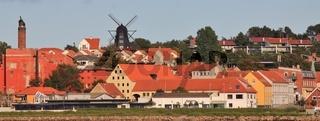 Black windmill and houses in Ebeltoft, Denmark.