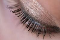 Closeup woman's eye with soft makeup