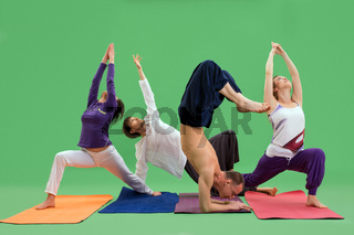 Men and women do yoga in studio green background