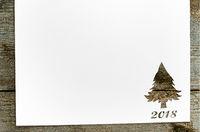 cut paper in fir-tree shape on table