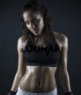 brunette woman smiling after workout . wet hair