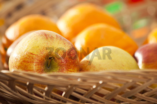vicker basket with apples and oranges