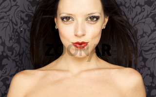 Close-up portrait of a beautiful woman with red lips .Warm yellow tones.