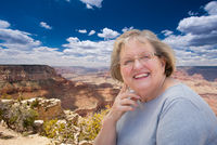 Happy Senior Woman Posing on Edge of The Grand Canyon