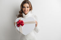 Woman holding heart gift