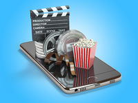 Mobile phone application for creating, seeing end editing video files and buying cinema tickets online. Smartphone with film reels, pop corn and clapperboard.