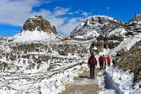 Hikers on the Three Peaks Circular Walk near Dreizinnenhütte, Rifugio Locatelli hut,Dolomites,Italy