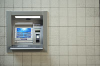 ATM machine. Automated teller bank cash machine on concrete wall.