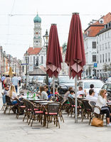 People at a street cafe in the city of Augsburg