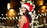 beautiful sexy woman in santa hat at christmas