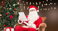 man in costume of santa claus with letter