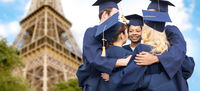 students or bachelors hugging over eiffel tower