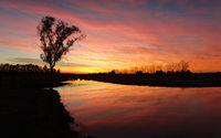 Vivid rural sunrise with fiery skies