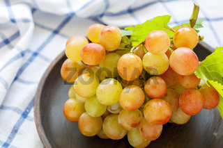 Bunch of grapes on a dish closeup.