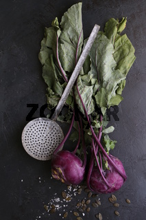Bunch of whole beetroots farm fresh on dark background