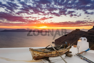 Old wooden boat on roof in Firostefani, Santorini island, Greece