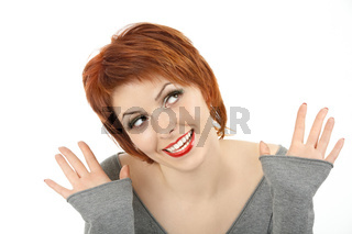 The beautiful red girl has lifted hands and looks upwards