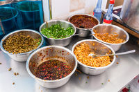 bowls with seasonings, spices and toppings