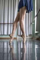 Legs of dancer in ballet hall